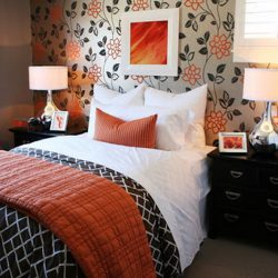 Elegant, modern bedroom with orange accents. Framed art are my own photos.